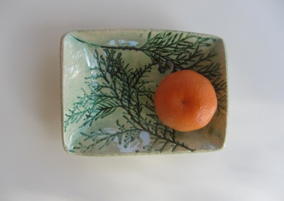 Fir dish with tangerine