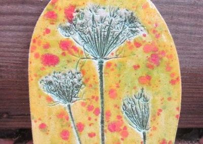 Wild carrot in copper on yellow